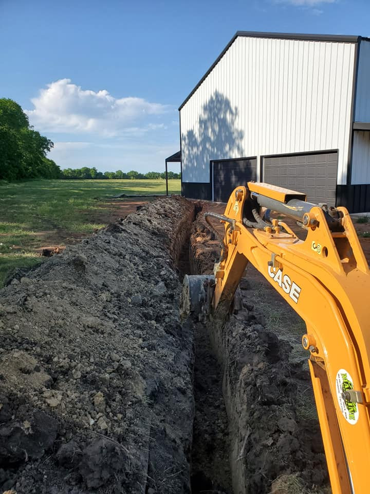 tractor digging while building a barndominium
