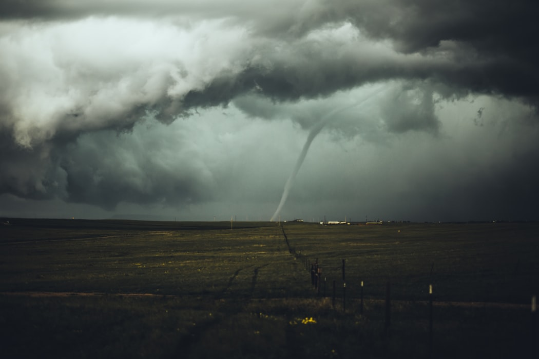 tornado next to barndominium