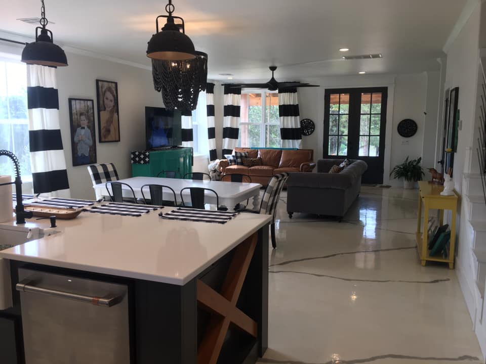 Black and White Oklahoma Barndominium open-space concept kitchen and living room
