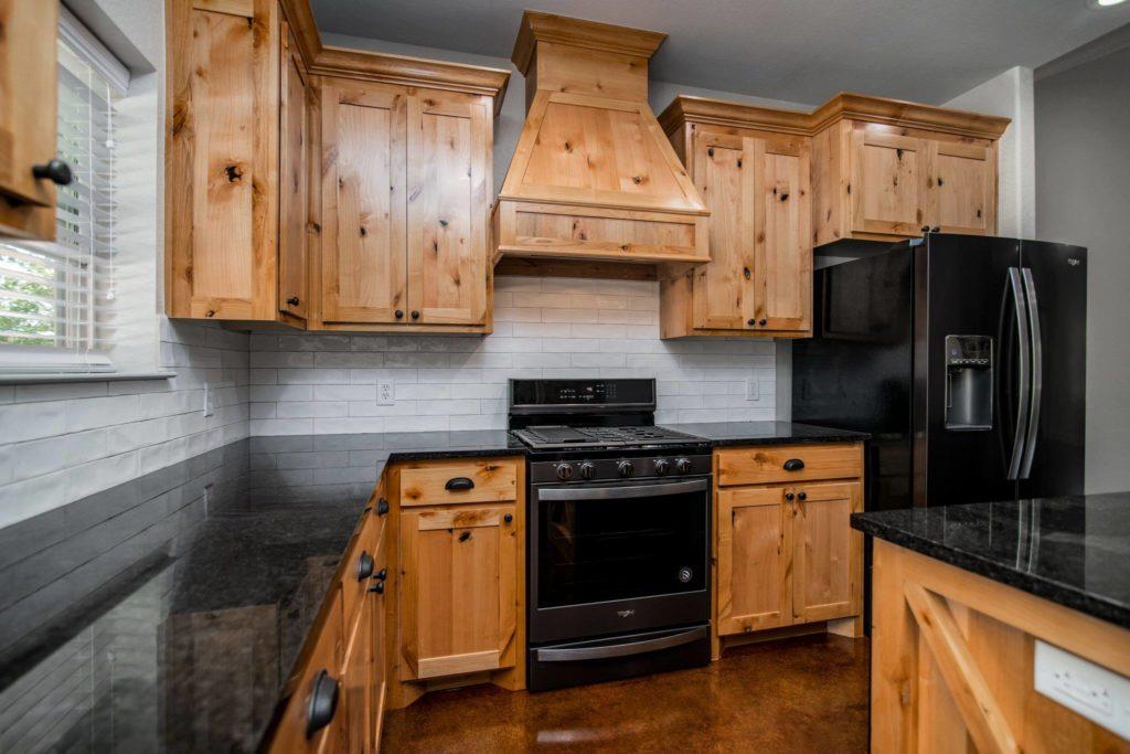 Mineral Wells Barndominium wooden kitchen furniture