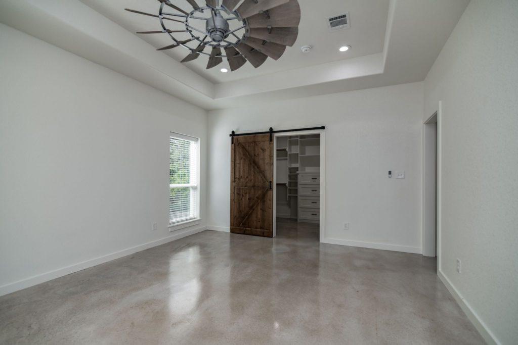 Texas Barndominium master bedroom door to closet