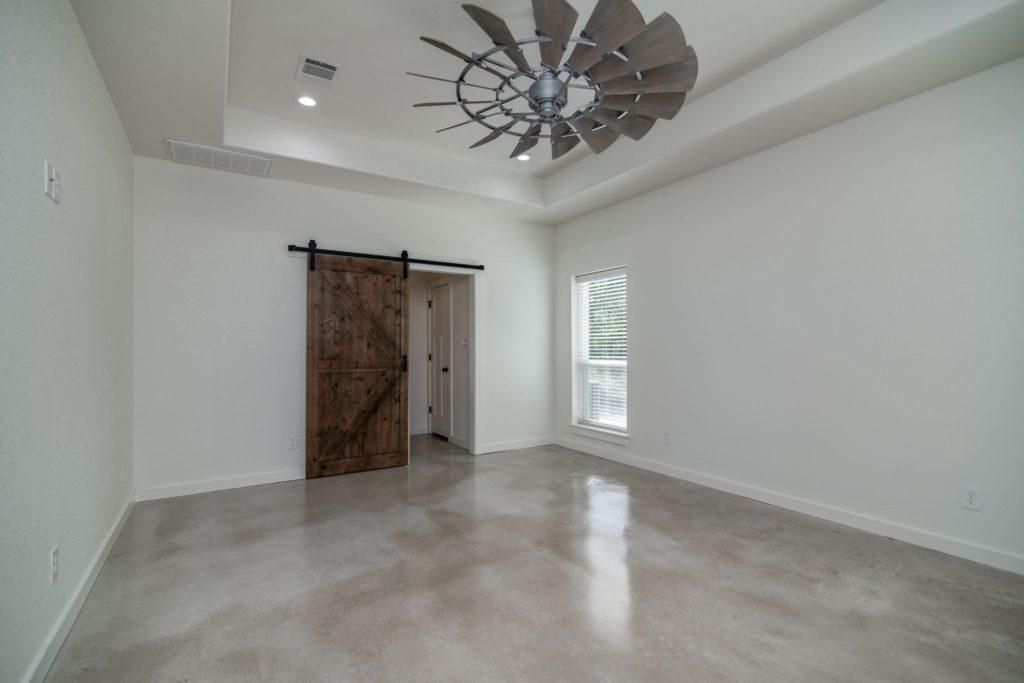 Texas Barndominium master bedroom door to bathroom