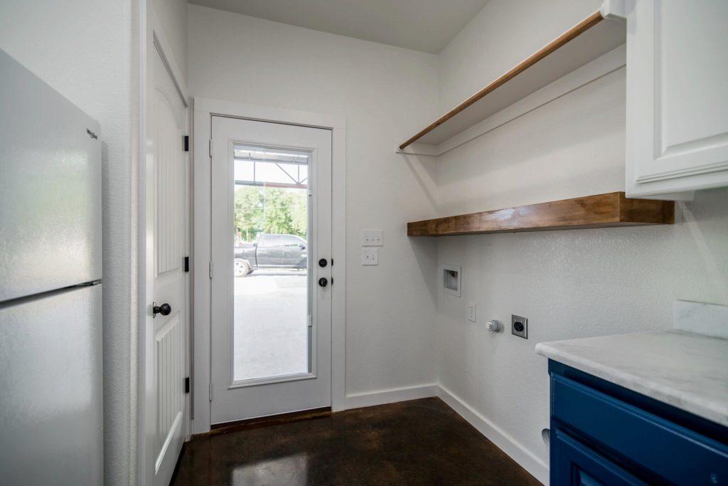 Rhome Texas Barndominium Laundry Room Door to Car Port