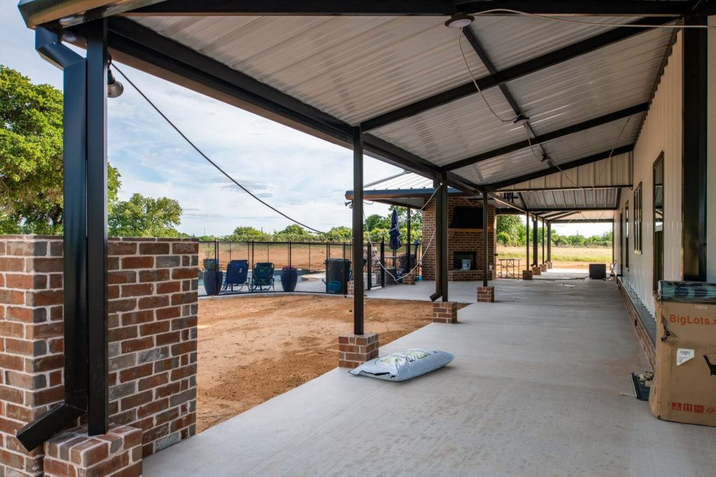 Rhome Texas Barndominium Porch Outdoor fireplace and pool
