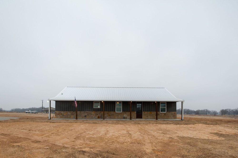 grey barndominium front view
