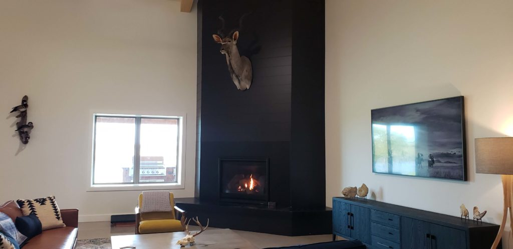Oklahoma Barndominium living room with huge fireplace