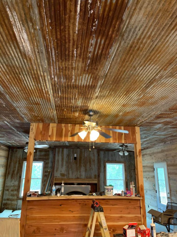 Reclaimed corrugated tins for the ceiling
