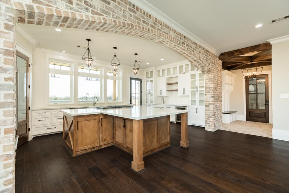 Houston Texas Barndominium Kitchen with Island and Archway