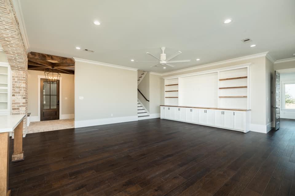 Houston Texas Barndominium Open Concept Living Room, Staircase and Back Door