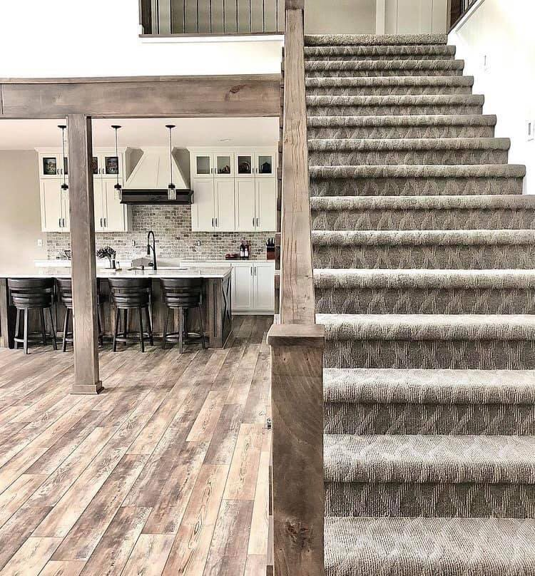 View of the stairs leading to second floor and view fo the kitchen
