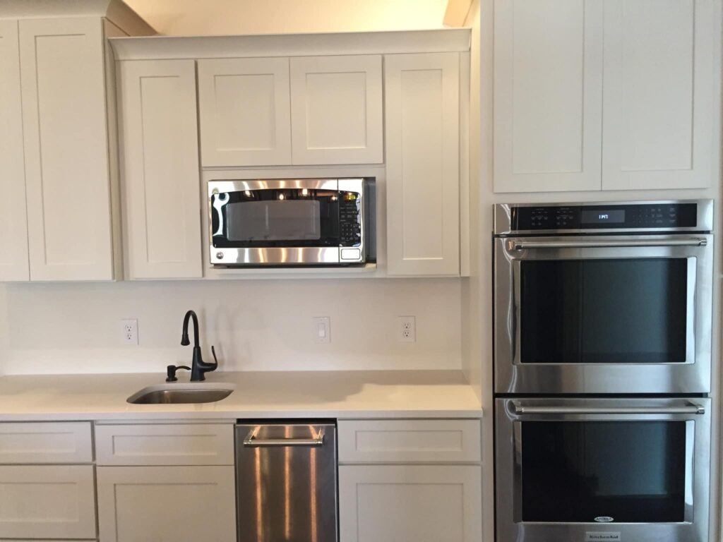 Kitchen sink, dual oven, and large microwave