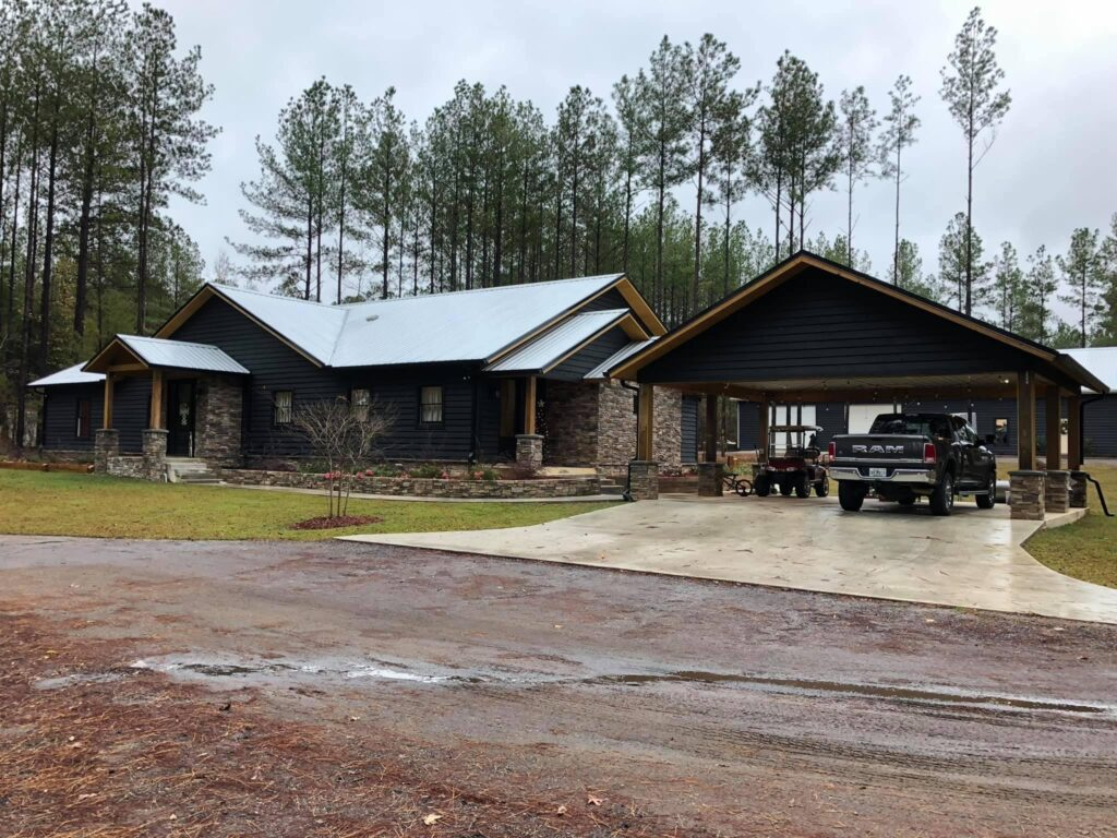 Odom Family Barndominium front view with parking space