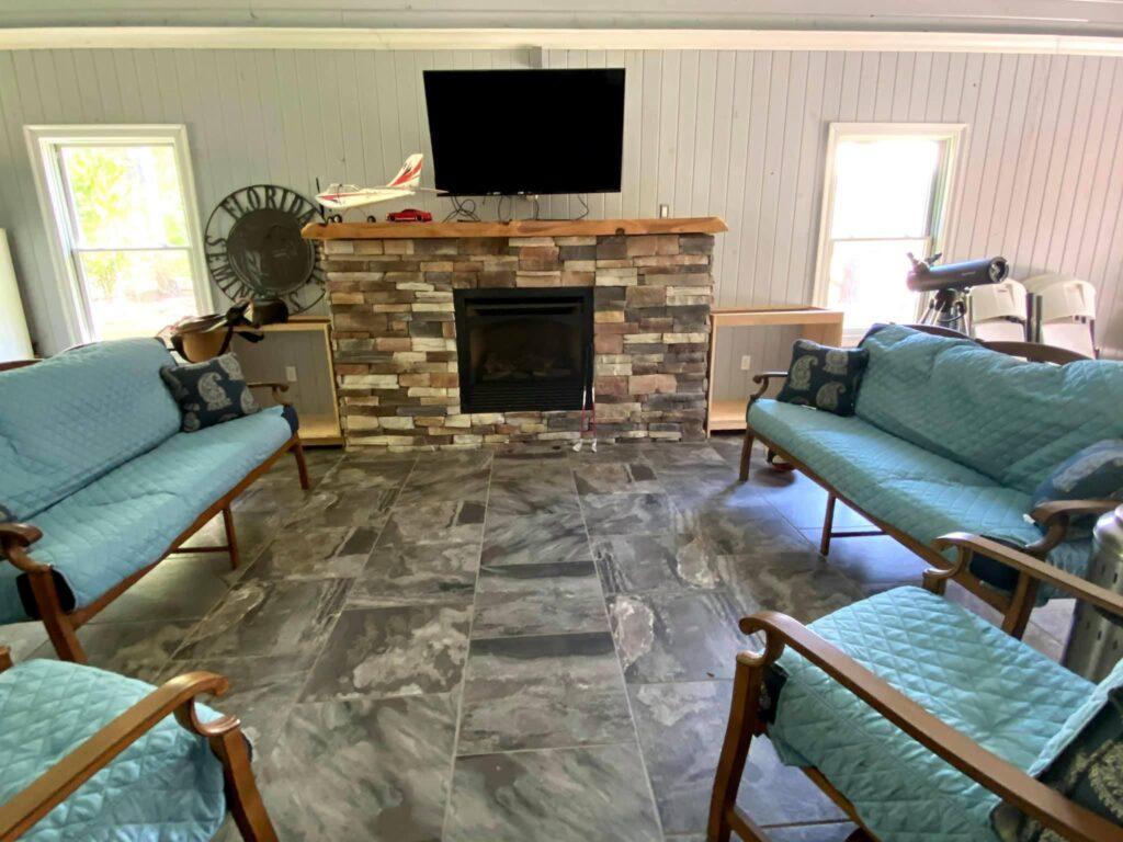 Open-air Indoor/outdoor room with fireplace
