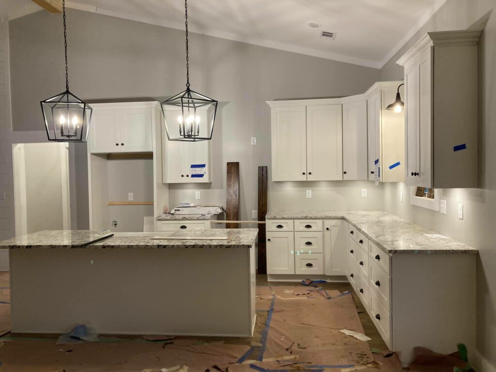 Kitchen including island, granite counters, and pendant lighting