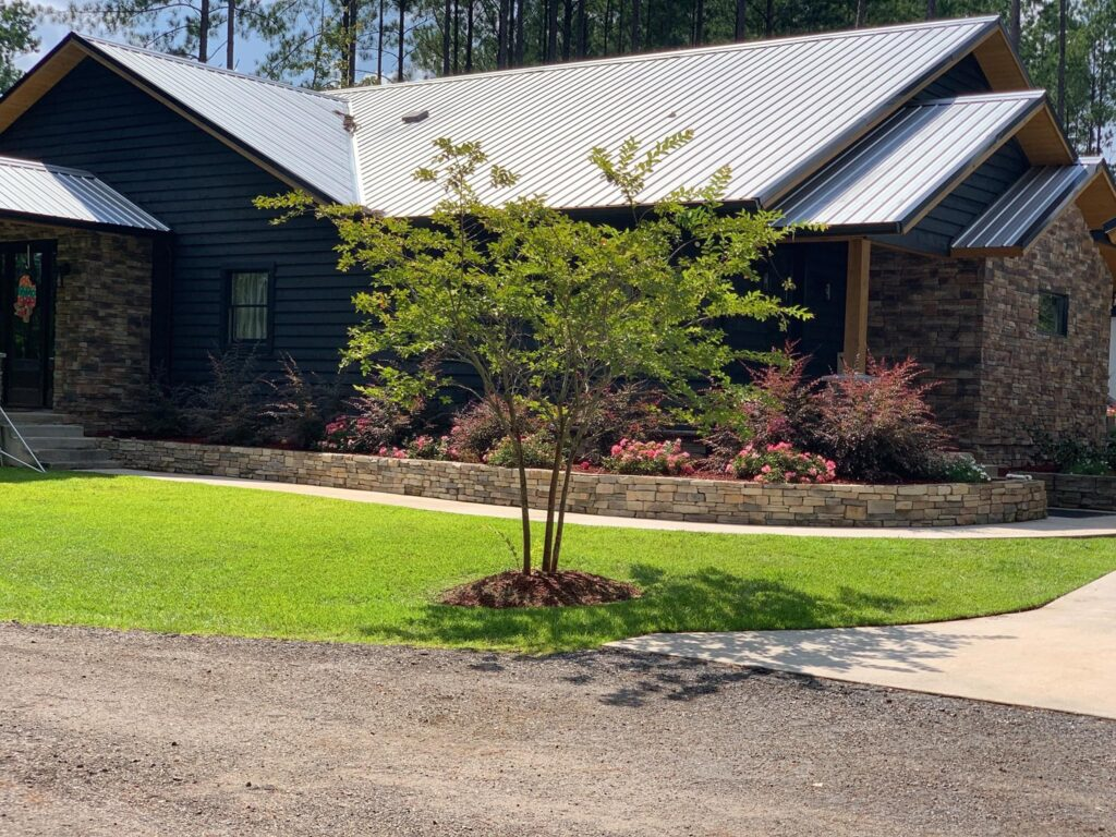 Barndominium front view with beautiful landscape