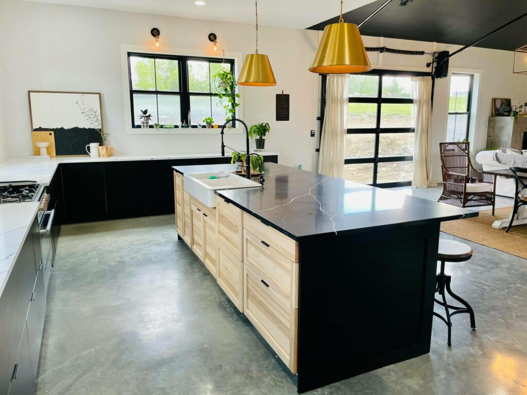 Kitchen Island with gold pendant lights.