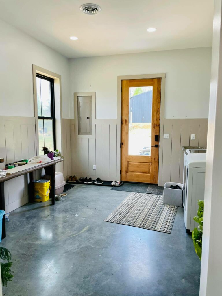 Laundry room with 3/4 glass exterior door.