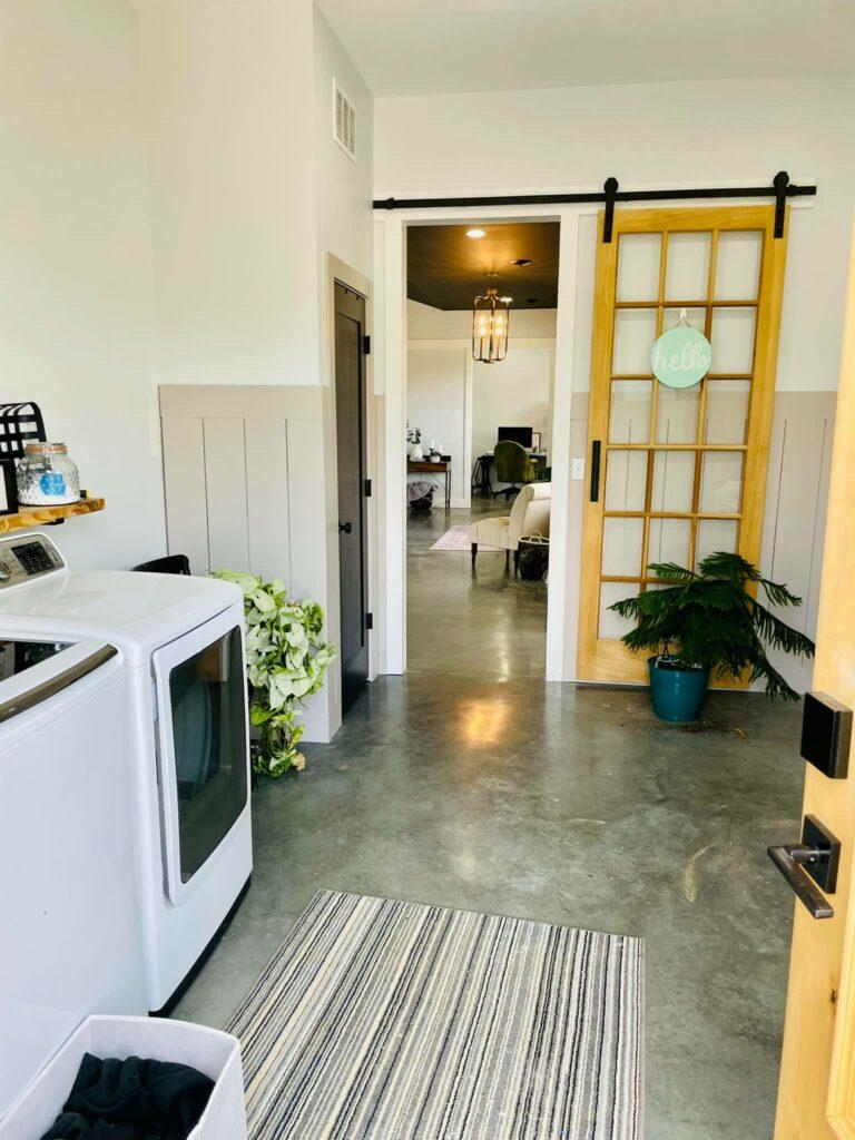 Laundry room with modern sliding door.