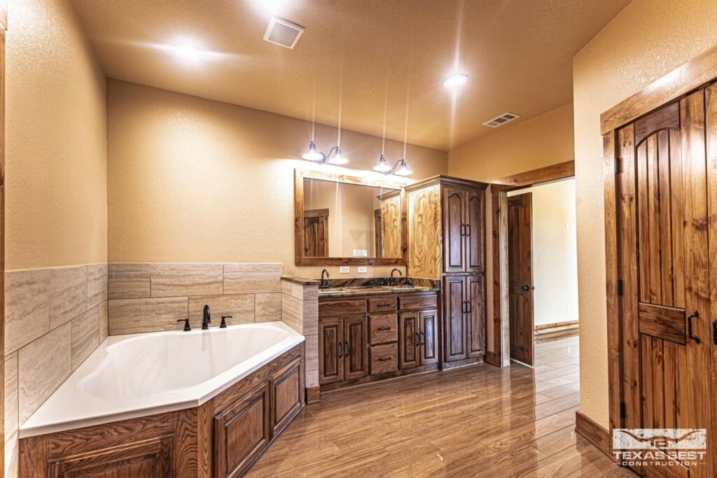 Master bathroom with walk-in closet and tall cabinetry