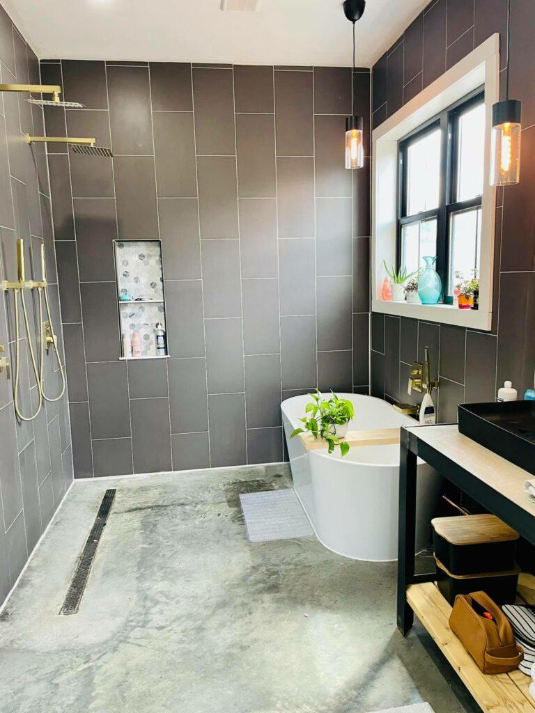 Shower room with bath and no shower door.