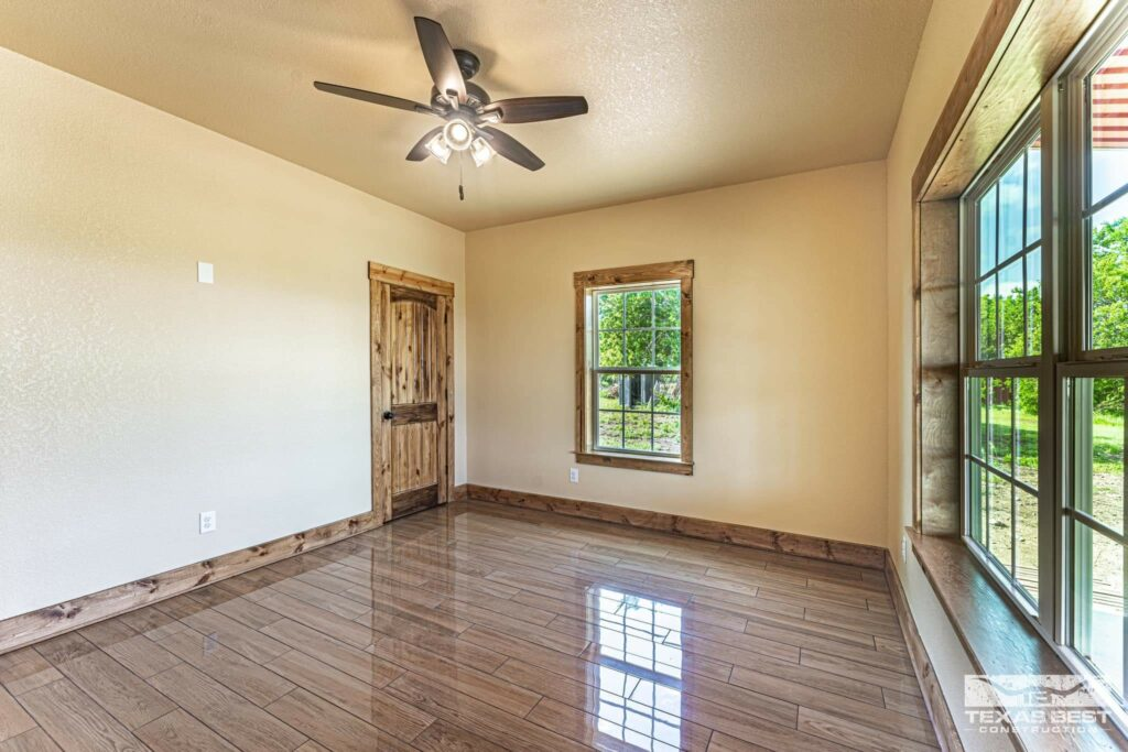 Bedroom with wood-stained trim and doors