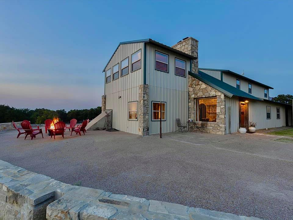 Unique Texas Hillside Barndominium with a Gorgeous View features lovely stone accents